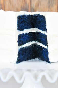 Blue Velvet Cake Recipe ½ cup Crisco 1 ½ cups sugar 2 eggs 1 ounce royal blue gel paste food color 2 drops violet gel paste food color 2 tablespoons cocoa 2 ¼ cups all-purpose flour 1 scant teaspoon salt 1 teaspoon vanilla 1 teaspoon soda 1 cup buttermilk 1 tablespoon vinegar