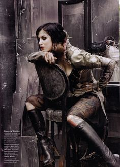 Kat Von D shot in skingraft coattails and vintage Moschino dress for Latina magazine, NOV 08 issue, wearing Etro boots.