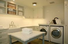Dream laundry room, just add an extra set of washers and dryers and it would be perfect. Laundry may actually be enjoyable this way. :) maybe.