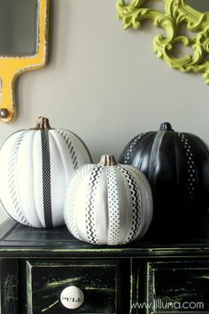 A coat of paint and black-and-white Washi tape gives these no-carve pumpkin decorations their style.