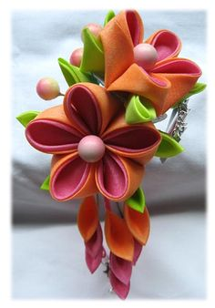 Pink and orange kanzashi by Thea Starr