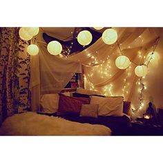 Paper lanterns, twinkle lights and sheer fabric