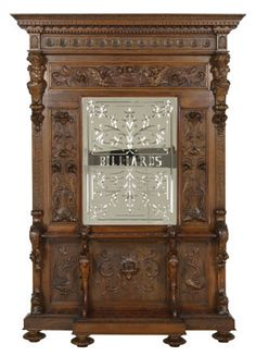 """19th century Italian Renaissance Revival carved black walnut cue rack with central Venetian wheel cut mirror engraved """"Billiards"""" framed by relief carved foliate panels flanked by opposing male term figures"""