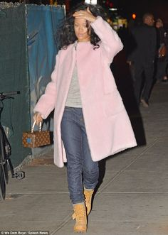 Rihanna in Rochas boiled-wool collarless coat, Louis Vuitton bag, Timberland boots - In New York City.  (October 2014)