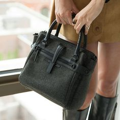 Elliott Lucca Iara Midi Tote  The new updated version of the Iara is small enough to carry everywhere. Wear it as a tote or a crossbody. We love all the pockets and compartments to keep you organized on the go.