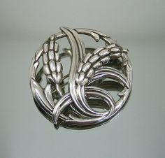 This classic vintage (circa 1940's) sterling Danecraft brooch features a wheat design with art nouveau influences.