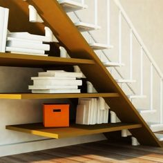 Amazing Under Bookshelf Stair With Wooden Bookcase Design. http://katlourenco.com/best-of-bookshelf-stairs-arrangement-for-beautify-your-living-room-decoration/amazing-under-bookshelf-stair-with-wooden-bookcase-design/
