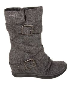 Keeping those extra inches under wraps, these boots feature a hidden wedge for a fashion-forward boost. Crossover buckle details complete the look with urban-chic appeal.
