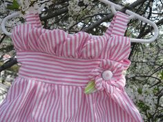 Easter is just around the corner… You know your little girl needs this dress:) With a happy little flower and darling petal top And of course some lovely little bows in back This was actually for a baby shower gift. Little miss will be wearing her bubble skirt Ready to get started? I promise you can do it! Materials: 1/2 yardish fabric: I used seersucker.