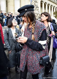 The sailor style cap has been contributing to very stylish outfits! Here is a beautiful street style look... how to style cap and sleeveless coat...