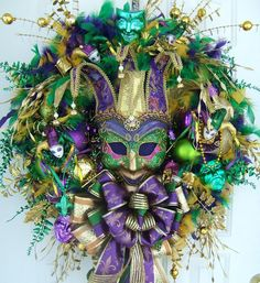 Luxe Mardi Gras wreath with Jester mask and floral sprays