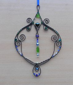 Items similar to Wire - wrapping ornament with cut beads. on Etsy
