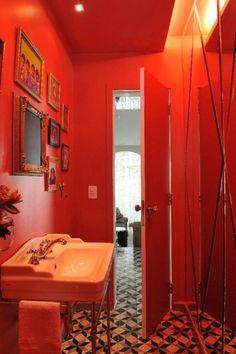 red bathroom + cool flooring