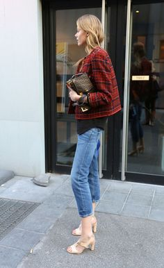 Frida Gustavsson street style BLUE JEANS +NEUTRAL SHOES+BLACK TOP+CHECKED BURGUNDY JACKET+ FENDI BAG