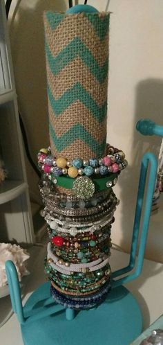 Vintage metal paper towel holder, teal spray paint, paper towel cardboard roll wrapped in a teal painted Chevron burlap = bracelet display