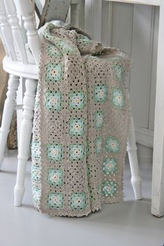 I like this Granny Square crochet blanket - make some squares using your background color :)