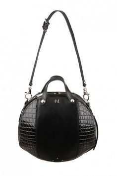 Leather handbag from the french designer Nicolas TheilMade in the Parisian atelier of the designer, this sac combines traditional know-how and unique design. Handcrafted leather and crocodile prints. Two pockets inside. Leather handles