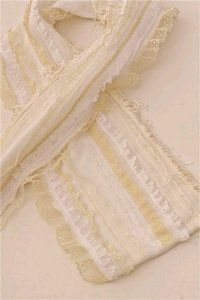 This scarf has lace and other romantic edging.  Plus it's easy to make.  It's Victorian Style lends itself to Steampunk influences.