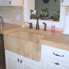 Light colored concrete counters with integrated concrete apron sink.  www.naishdesigns.com (@romeoconcrete)