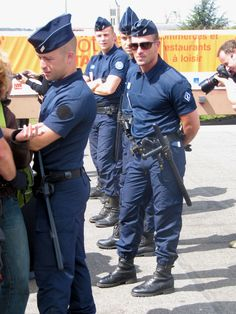 French police officers, short and stocky, beefy men, unifom