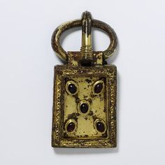 buckle, France  450-550  Gilded copper alloy, set with garnet-coloured glass