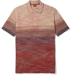 Missoni delivers a standout piece for Spring 2014 with this striped polo shirt. Meticulously crafted in Italy, the streamlined fitted shirts is composed of a lightweight cotton composition, while warm, sunset colors in various horizontal stripe knits provide an aesthetically pleasing effect overall. Find this perfect warm weather shirt now at select Missoni stockists worldwide.