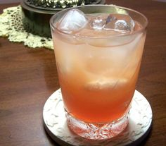 Bahamas Rum Punch ~ 1/2 ounce Campari Orange, 1 ounce Light Rum  1/2 ounce Coconut Rum, Orange Juice, Pineapple Juice