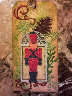 Diane Krause as the Happy Scrapper with a Tim Holtz Christmas glitter tag; Dec 2013