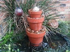 Even the simplest of flower pots can have a really dramatic impact if you use them creatively - nice use of  our standard flower pots