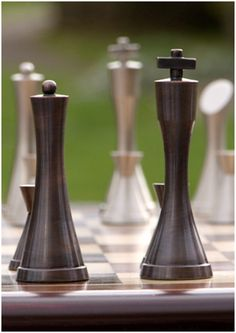 contemporary heavy pewter and copper chess set Modern Chess Set, Giant Yard Games, Chess Table, Art Through The Ages, Wood Games, Different Kinds Of Art, Kings Game, Chess Pieces, Wood Turning