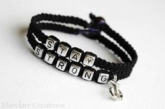 Set of Two Black Stay Strong Bracelets with Silver Tone Anchor