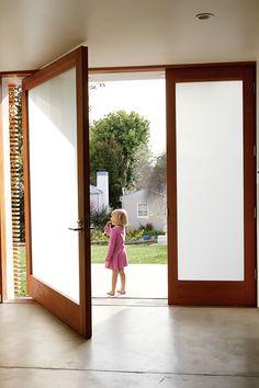 Pivoting Door - super modern and way cool.