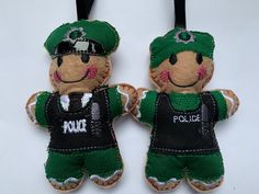This Northern Ireland Police Officer has just been added to my Gingerbread collection. The perfect retirement gift! #police #northernireland #gingerbreadman #retirementgiftideas Funky Cushions, Handmade Cushions, Gingerbread Man Decorations, Baby Banners, Knit Baby Booties, Dog Bag, Felt Baby, Retirement Gifts, Festival Decorations
