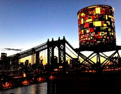 "Water tower in Brooklyn - Artist Tom Fruin's colored plexiglass ""water tower"" sculpture was revealed at an opening reception on June 7, 2012 on the rooftop of 20 Jay St. in DUMBO, Brooklyn, NY."