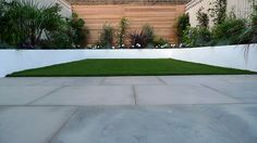 sawn grey sandstone paving raised rendered beds hardwood screen painted stone fence london small garden design (6)
