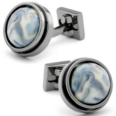 Button-style cufflinks are given a fresh look with smooth stone facades in swirls of blue, gray, and ivory. The melding hues are complimented by a round rivet-style setting in Black Chrome. The hardware and fixture echo the chrome finish, and give an industrial-edge to a...