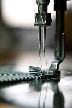 stitch by stitch. sewing machine. needle. photography.