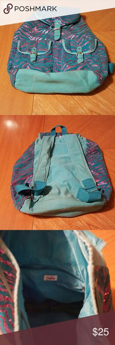 Justice Backpack Super cute Justice backpack in great condition. Needs a little love but has no tears rips or stains just a little dirty on bottom of bag as shown in picture. Justice Bags Backpacks