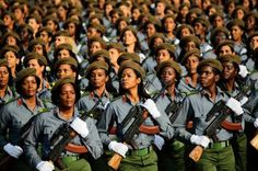 Cuban soldiers march during a military parade in Havana's Revolution Square April 16. Cuba readied for a Communist Party congress about its future with a tribute to the past, staging a military parade for the 50th anniversaries of the U.S.-backed Bay of Pigs invasion.