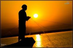 Fishing. #fisherman #sunrise #fishing #silhouette #sky #nature #water #sea #outdoor #fish #lake #catch #river #summer #landscape #morning #people #ocean #relaxation #light #reel #boat #night #orange #dusk #vacation #casting #action #photographer