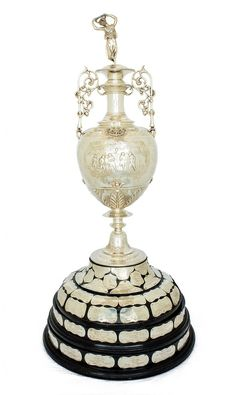 The Football League First Division Trophy,  first awarded to the Football League Champions in 1891 and used continuously until 1992. This trophy is also known as 'The Lady' due to the statuette that adorns the top.