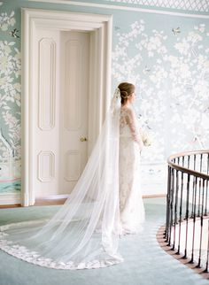 Stunning lace tipped cathedral length veil: http://www.stylemepretty.com/2015/12/16/classic-tennessee-estate-wedding/ | Photography: Leslee Mitchell - http://www.lesleemitchell.com/