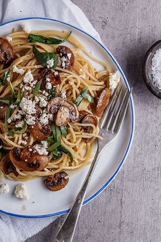 This delicious spaghetti is topped with buttery garlic mushrooms, sautéed spinach and feta. Check out the recipe at simplydeliciousfood.com