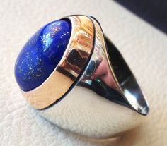 lapis lazuli oval cabochon natural blue stone ring bronze and