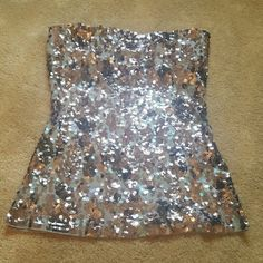 Sequin Halter This stunning, strapless top came from Express and has been worn twice. Flawless condition, so go make a statement! The back is plain grey. Express Tops