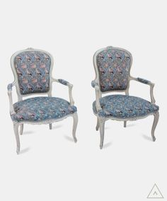 Pair of Louis XV style cream painted fauteuils with needlework upholstery depicting birds and flowers in pink on a pale blue ground.  Explore interior design inspiration and shop vintage furniture, antique furniture, contemporary furniture and mid-century designs.