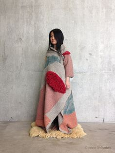 Created in collaboration with a wool manufacturer in Spain, Irene Infantes uses the technique of screen printing to create her ethereal textiles. The detailing of geometric forms emphasise the structural… Irene, Wearable Blanket, Textiles, Central Saint Martins, Red Apple, Interior Design Inspiration, Shawls, Apples, Merino Wool