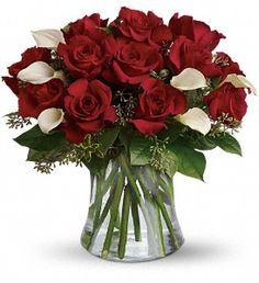 The look of love is charmingly reflected in this romantic array of red roses and fragrant white callas. #Valentines