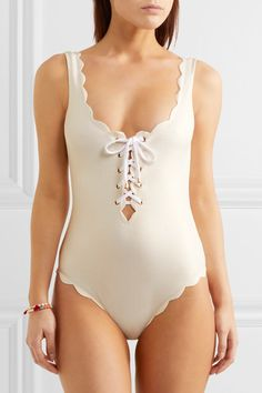 Cream and gold stretch-crepe Pulls on 88% polyamide, 12% elastane Hand wash Lotion, sunscreen, oil and chlorine can cause discoloration of this item; this is not a manufacturing defect. Please follow care instructions to keep your swimwear in the best condition As seen in The EDIT magazine