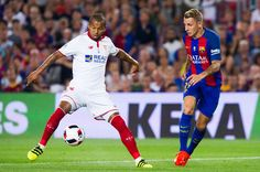 Mariano Ferreira (L) of Sevilla FC controls the ball next to Lucas Digne (R) of FC Barcelona during the Spanish Super Cup Final second leg match between FC Barcelona and Sevilla FC at Camp Nou on August 17, 2016 in Barcelona, Catalonia.